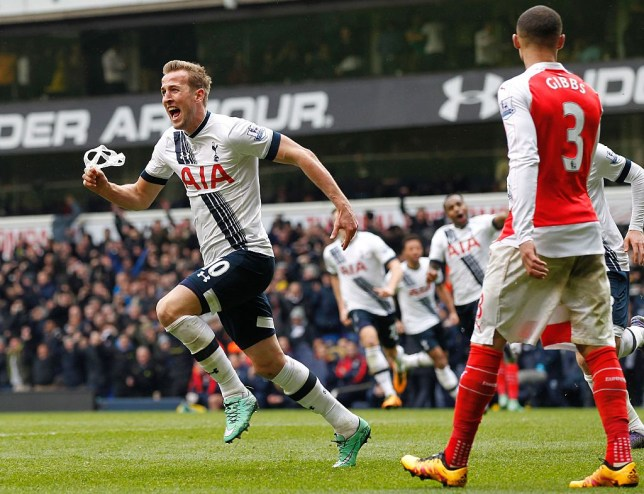 Tottenham Hotspur's English striker Harry Kane (L) celebrates after scoring their second goal during the English Premier League football match between Tottenham Hotspur and Arsenal at White Hart Lane in London, on March 5, 2016. / AFP / IKIMAGES / IKimages / RESTRICTED TO EDITORIAL USE. No use with unauthorized audio, video, data, fixture lists, club/league logos or 'live' services. Online in-match use limited to 45 images, no video emulation. No use in betting, games or single club/league/player publications. (Photo credit should read IKIMAGES/AFP/Getty Images)