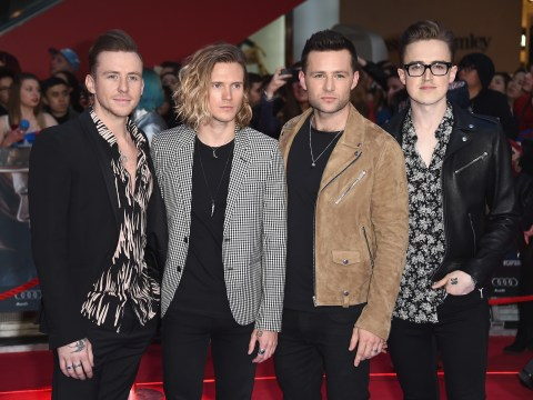 McFly postpone their tour after Harry Judd suffers a neck injury