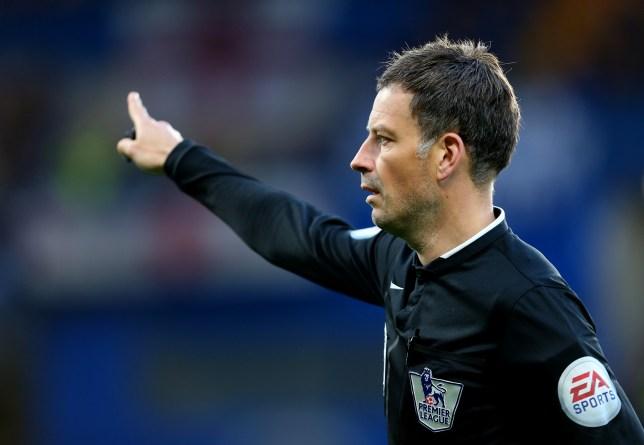 Mark Clattenburg points during a game