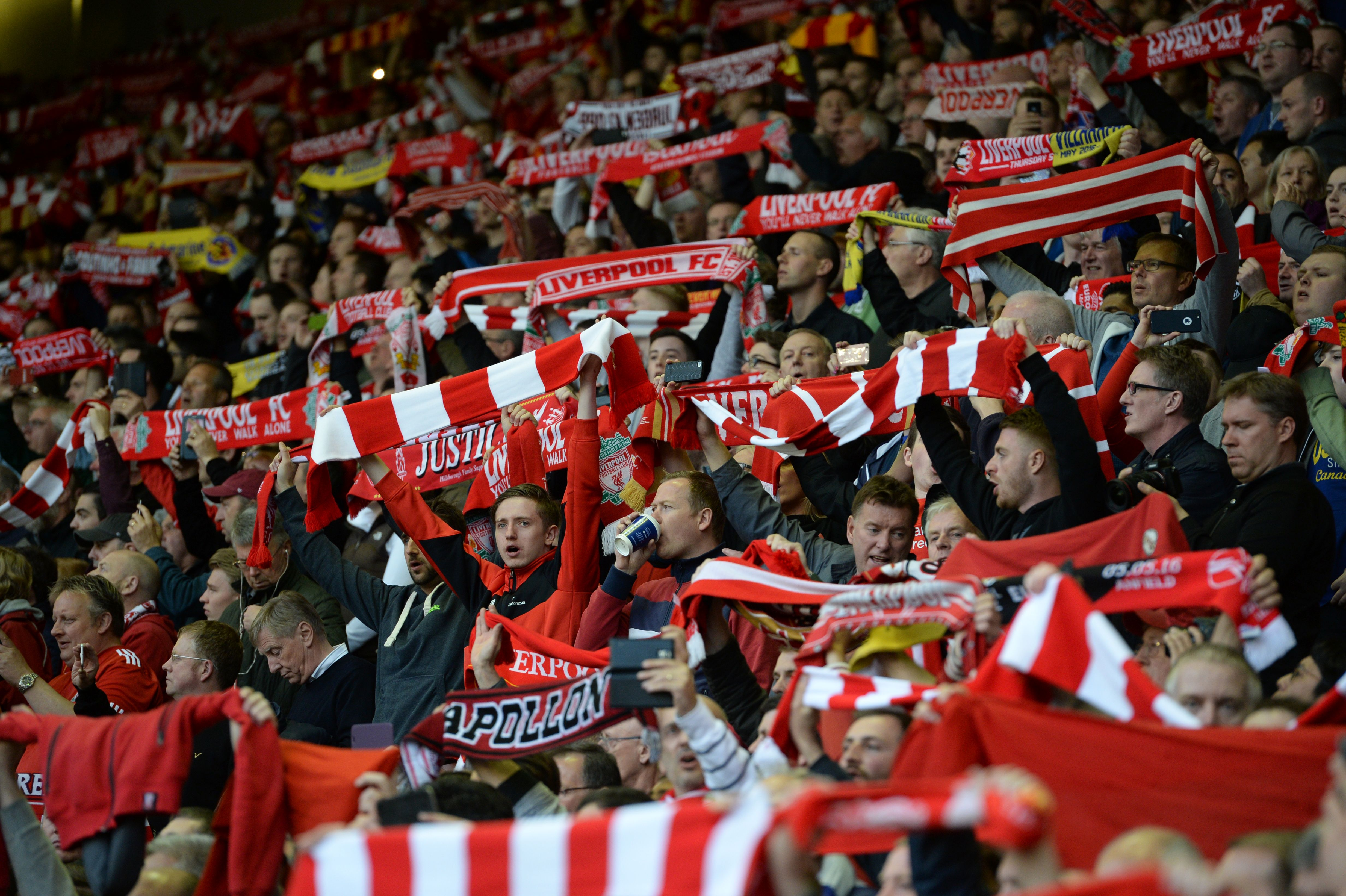 Liverpool fans cheer their team during the UEFA Europa League semi-final second leg football match between Liverpool and Villarreal CF at Anfield in Liverpool, northwest England on May 5, 2016. / AFP / OLI SCARFF (Photo credit should read OLI SCARFF/AFP/Getty Images)