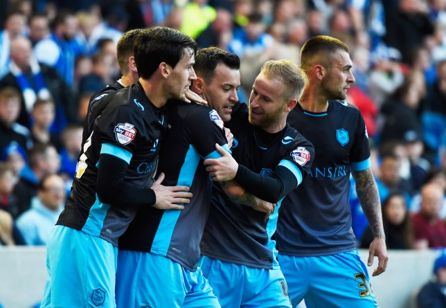 BRIGHTON, UNITED KINGDOM - MAY 16: Ross Wallace of Sheffield Wednesday (C) celebrates with team mates as he scores their first and equalising goal during the Sky Bet Championship Play Off semi final second leg match between Brighton & Hove Albion and Sheffield Wednesday at the Amex Stadium on May 16, 2016 in Brighton, United Kingdom. (Photo by Mike Hewitt/Getty Images)