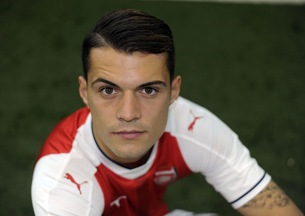 Granit Xhaka can become as good as Andrea Pirlo under Arsene Wenger, claims Johan Djourou