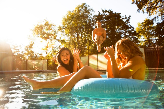 Three friends enjoying a day at the pool.