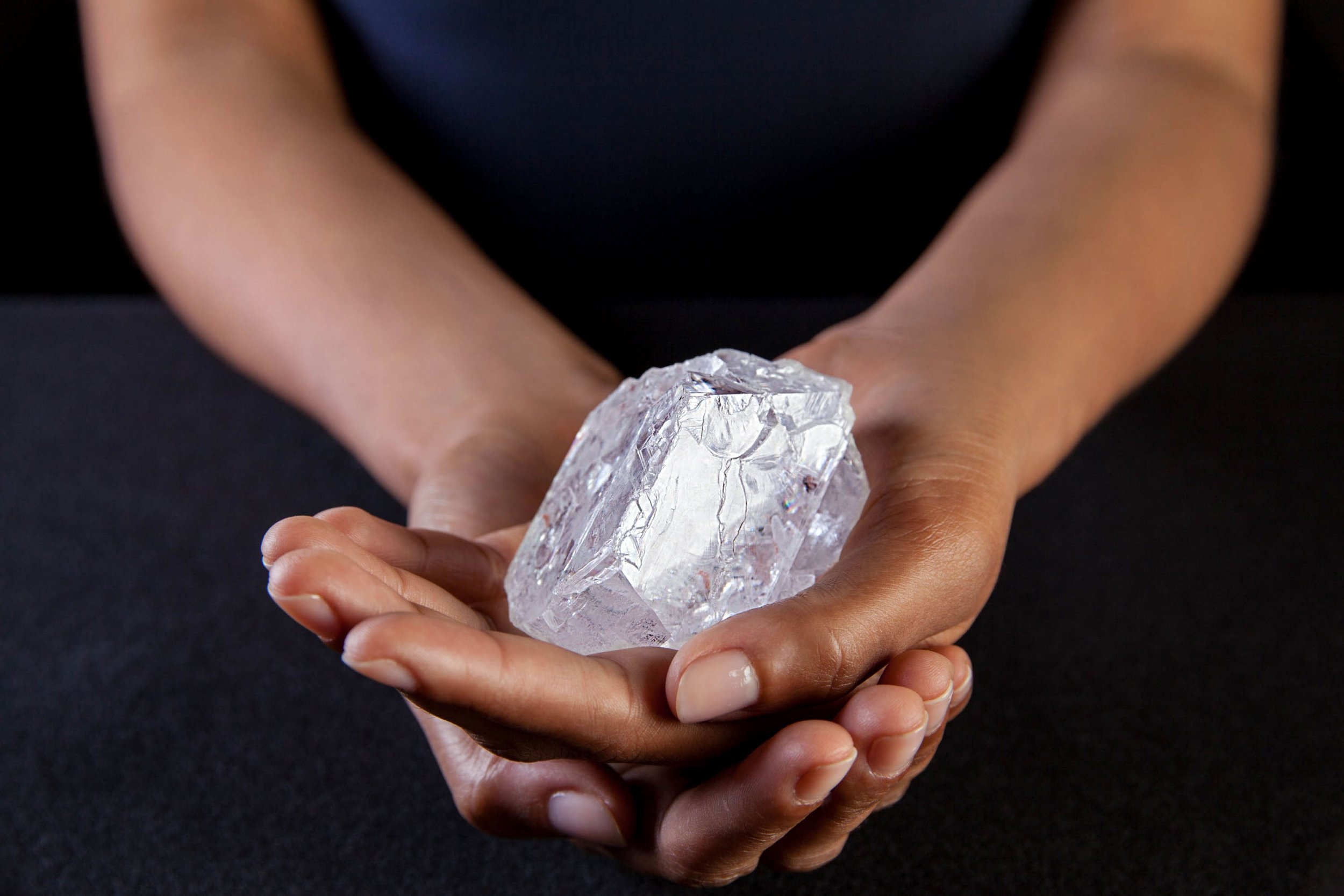 A Sotherby's employee holds Lesedi La Rona Diamond on May Tuesday 3, 2016 in New York City. The diamond the size of a tennis ball that is the largest discovered in more than a century could sell at auction for more than $70 million. Sotheby's says it will offer the Lesedi la Rona diamond in London on June 29. (Donald Bowers/Getty Images for Sotheby's, via AP)