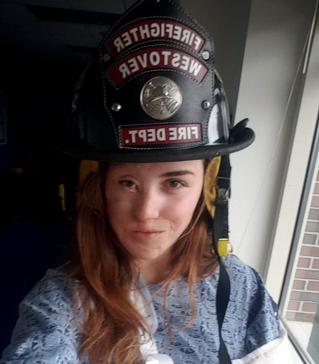 PIC FROM CATERS NEWS - (PICTURED: Tatyana cant wait to become a firefighter) - A stunning burns survivor left with half a face has defied cruel bullies by training to become a FIREFIGHTER. Tatyana Shakhray, 18, from Worcester, Massachusetts, suffered third degree burns to the left side of her face, right hand and stomach when she was just six months old after she tumbled onto a scorching hot woodstove. After enduring years of staring, and spiteful comments, the beautiful teen is now having the last laugh as she trains to tackle fires and selflessly help other victims. Tatyana has had over 100 surgeries over her lifetime for her burns and despite being mocked for her appearance she now has more confidence than ever after meeting love of her life, Mason Philips, 19. SEE CATERS COPY.