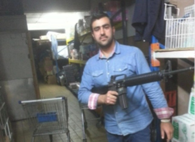 epa05297450 An undated handout photograph released by Italian Police Carabinieri on 10 May 2016 shows alleged Afghan terrorist Hakim Nasiri holding a gun. Two Afghan nationals were detained by Carabinieri police from the southern city of Bari on 10 May 2016 in relation to an investigation into alleged plans to stage terrorist attacks in Italy and Britain, ANSA sources said. Hakim Nasiri, 23, is accused of international terrorism, and Gulistan Ahmadzai, is accused of aiding illegal immigration. EPA/ITALIAN POLICE CAARIBINIERI / HANDOUT HANDOUT EDITORIAL USE ONLY/NO SALES