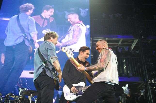 11 May 2016. James Bourne, Charlie Simpson and Matt Willis of 'Busted' performing at SSE Arena in London. Credit: GoffPhotos.com Ref: KGC-138