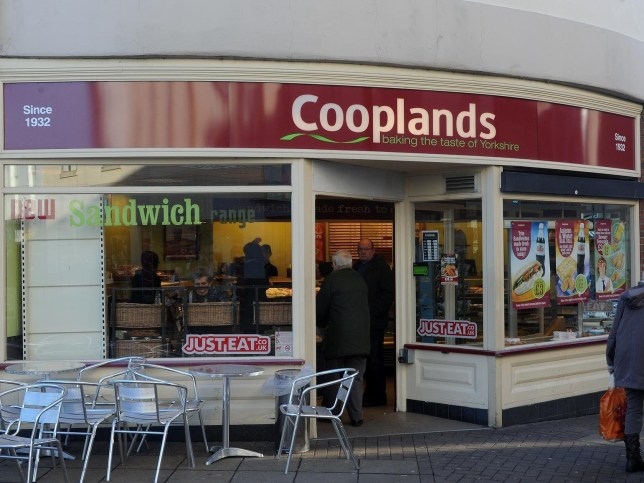 "The Cooplands branch in Baxtergate where the t-shirts were spotted. See Ross Parry copy RPYROLLS : A bakery has been slammed by customers after staff were spotted wearing ""offensive"" t-shirts baring the slogan ""sex, drugs and sausage rolls"". Workers at bakery firm Cooplands were spotted wearing the t-shirts at a branch in Doncaster town centre, South Yorks., yesterday (12/5). One customer, who objected to the t-shirts but didn't want to be named, said: ""The use of the words sex and drugs in a public area of a food outlet is, in my eyes, inappropriate and could be offensive to shoppers across the age spectrum. Credit: SWNS"