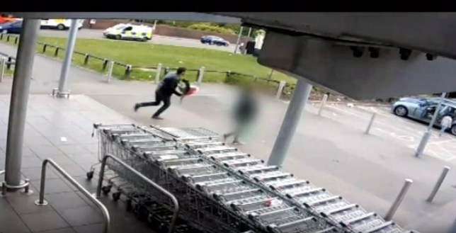 CCTV of a carjacking at an Aldi supermarket in Gorton, Manchester in which a man in tracksuit tried to rob a car with a wife and child inside. The woman's husband who had bought a bunch of flowers is seen running towards the vehicle as its being stolen. Disclaimer: While Cavendish Press (Manchester) Ltd uses its' best endeavours to establish the copyright and authenticity of all pictures supplied, it accepts no liability for any damage, loss or legal action caused by the use of images supplied. The publication of images is solely at your discretion. For terms and conditions see http://www.cavendish-press.co.uk/pages/terms-and-conditions.aspx