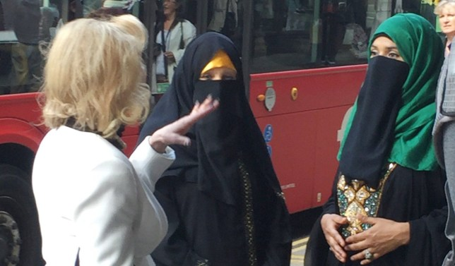 Anne Robinson (wearing the yellow trim hijab/burka) Interviews members of the public on Kensington High Street London 24/05/16 Asking peoples thoughts on the subject of the burka & people covering up in general in the UK Paul Hennessy/Lam Ferri/MailOnline Paul Hennessy/Lam Ferri/MailOnline
