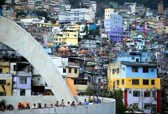RIO DE JANEIRO, BRAZIL - JUNE 09: A general view of locals from the Rocinha favela watching as the England team visit Complexo Esportivo da Rocinha on June 9, 2014 in Rio de Janeiro, Brazil. (Photo by Richard Heathcote/Getty Images)