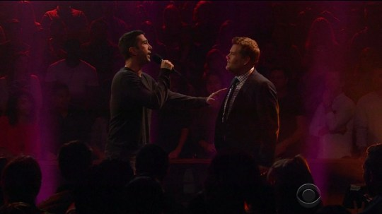 """27 May 2016 - Los Angeles - USA **** STRICTLY NOT AVAILABLE FOR USA *** Rebel Wilson beats David Schwimmer and James Corden in rap battle on The Late Late Show. Schwimmer and Corden went head to head in the rap battle on only for both to be beaten by actress Rebel Wilson. The former Friends star mocked the host for being 'destroyed' earlier in the week by Anne Hathaway during a segment of Drop The Mic. The actor took to the stage wearing a Rocky-style boxing robe before the pair went to work in the show's second rap battle of the week. Corden kicked off by teasing Schwimmer that no one actually remembered who he was. Corden rapped: """"Millennial let me introduce you to this guy, his name is David he was famous back in '95. That's when he was hot, he was on TV then, now its 2016 and he has no friends, get it, no Friends, not famous ever again. He was a Kardashian on TV but that was only for pretend. You played Robert and that was a great combo but you were so white you should have probably played the Bronco. Now you have the chance to prove you've got balls while I ignore you like Jennifer Aniston does your calls."""" Schwimmer was up to the challenge and got up close and personal to rap right into Corden's face, rapping: """"A Brit in America is your one claim to fame, we all know as an actor your roles were all the same. The heavy best-friend, the humorous sidekick with a belly so big you can't find your own d***. Dickens the author we all read as kids, he's British like you but people know who he is, you must be a masochist you want to battle me, this won't end well mate it's not Love Actually. To be clear I love the English, I married your kind, but why your wife chose you? My bad, she blind? Did you think I'd be scared, walk around gingerly when everyone knows your middle name is Kimberley?' I'm tall and lean, you're short and stout, they know me in Japan, they know you at In-N-Out. You embarrassed your country, this was easy for me, bitch lay down the mic and go mak"""