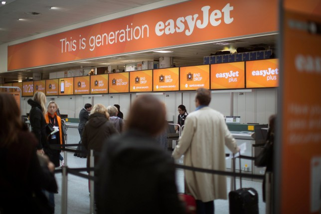 "A banner reads ""This is generation easyJet"" above the EasyJet Plc check-in desks inside the south terminal of London Gatwick airport in Crawley, U.K., on Thursday, Nov. 6, 2014. EasyJet has established a footprint at locations such as Amsterdam Schiphol, where it announced plans to base planes in July, and is ramping up operations at London Gatwick airport, its biggest single base. Photographer: Simon Dawson/Bloomberg via Getty Images"