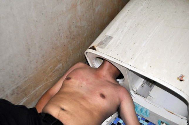 """Pic shows: Manís head stuck in the washing machine. A squad of firefighters in China have saved a man from his washing machine after he somehow managed to get his trapped inside the device. Reports said he was inspecting the machineís roller when he stuck his head in and could not get it out again. The unnamed victim from Fuqing, a county-level city in East Chinaís Fujian Province, is said to have been preparing to do his laundry when he turned on the power of the machine but noticed that it was not responding. After pressing a number of different knobs on the machine and getting no response, he thought the roller might have been malfunctioning due to a foreign object being stuck inside. The poor man then decided to stick his head into the cylindrical space to inspect the roller, but was horrified to find himself stuck in the machine. The victim later explained: """"I managed to very successfully stick my head into the machine, so I donít understand why I got stuck."""" The man, shirtless and flushed from trying to escape the washing machine, was found by his flatmate minutes later. The flatmate reportedly tried to free the man by applying soap to his neck, but all attempts were unsuccessful. In the end a team of six firemen arrived to rescue the man by sawing through the plastic roller and eventually pulling it apart. The entire rescue took about 40 minutes, reports said, with the victim suffering minor cuts on his head, but otherwise not in life-threatening condition. (ends)"""