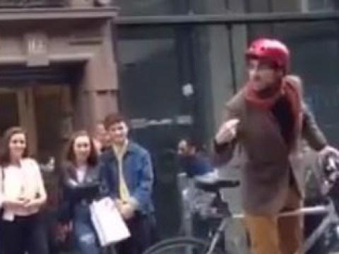 Homophobic preacher gets shutdown by passing cyclist