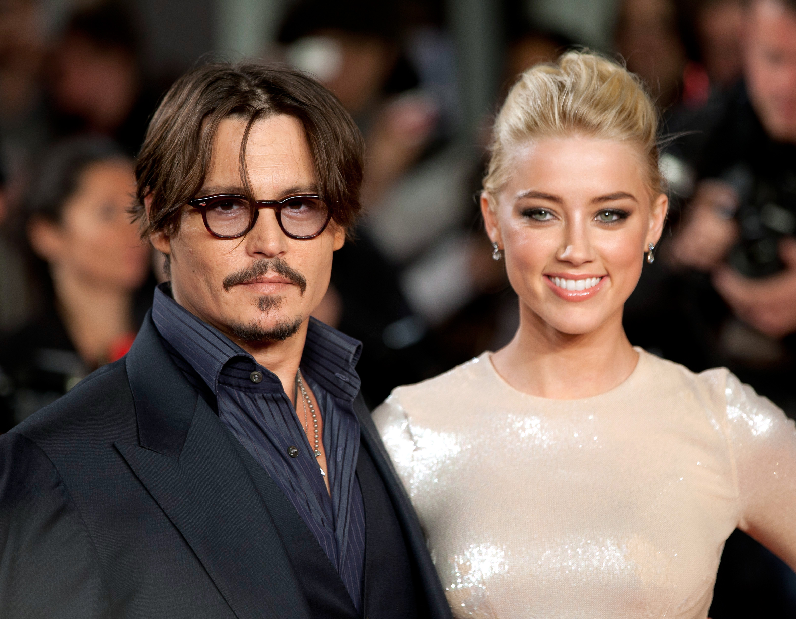 New texts allege Johnny Depp's PA knew about the 'domestic abuse' of Amber Heard