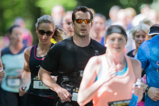 Superman actor Henry Cavill runs in the Durrell Challeng - a 13k road race held in Jersey (Picture: Ian Le Sueur/SWNS)