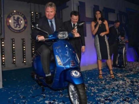 Guus Hiddink receives a Chelsea Vespa moped as a gift for his work with the club this season