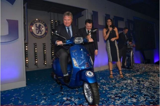 Hiddink hops on his new Chelsea-themed Vespa (Picture: Press Association)