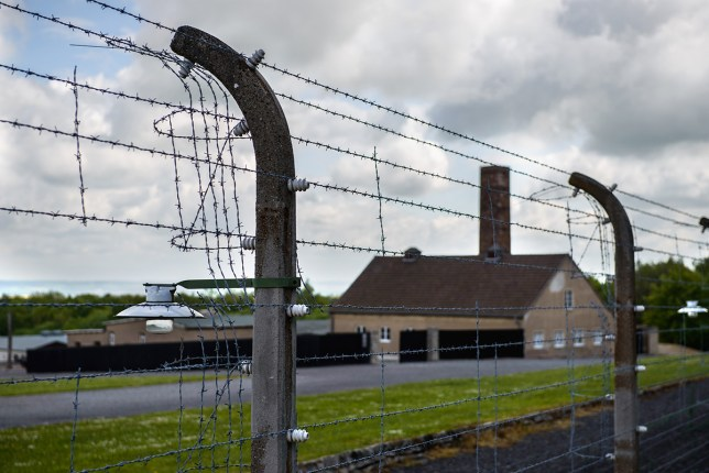 The crematorium of the former Buchenwald concentration camp is pictured behind barbed wire fence in Weimar,Germany, 14 May 2014. The present-day Buchenwald memorial is part of the Buchenwald Concentration Camp and Mittelbau Dora Concentration Camp memorial foundation which was established by the state of Thuringia and the Federal government. Photo: CANDY WELZ/dpa Credit: PA