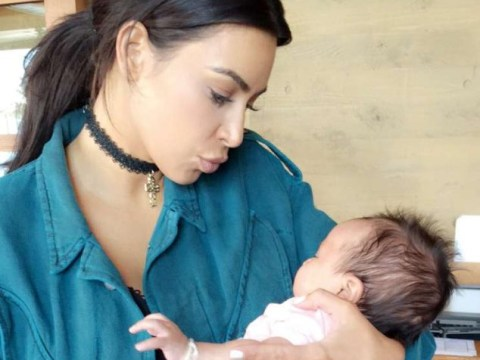 Kim Kardashian and Kanye West dote on John Legend's new baby during brunch date with Saint