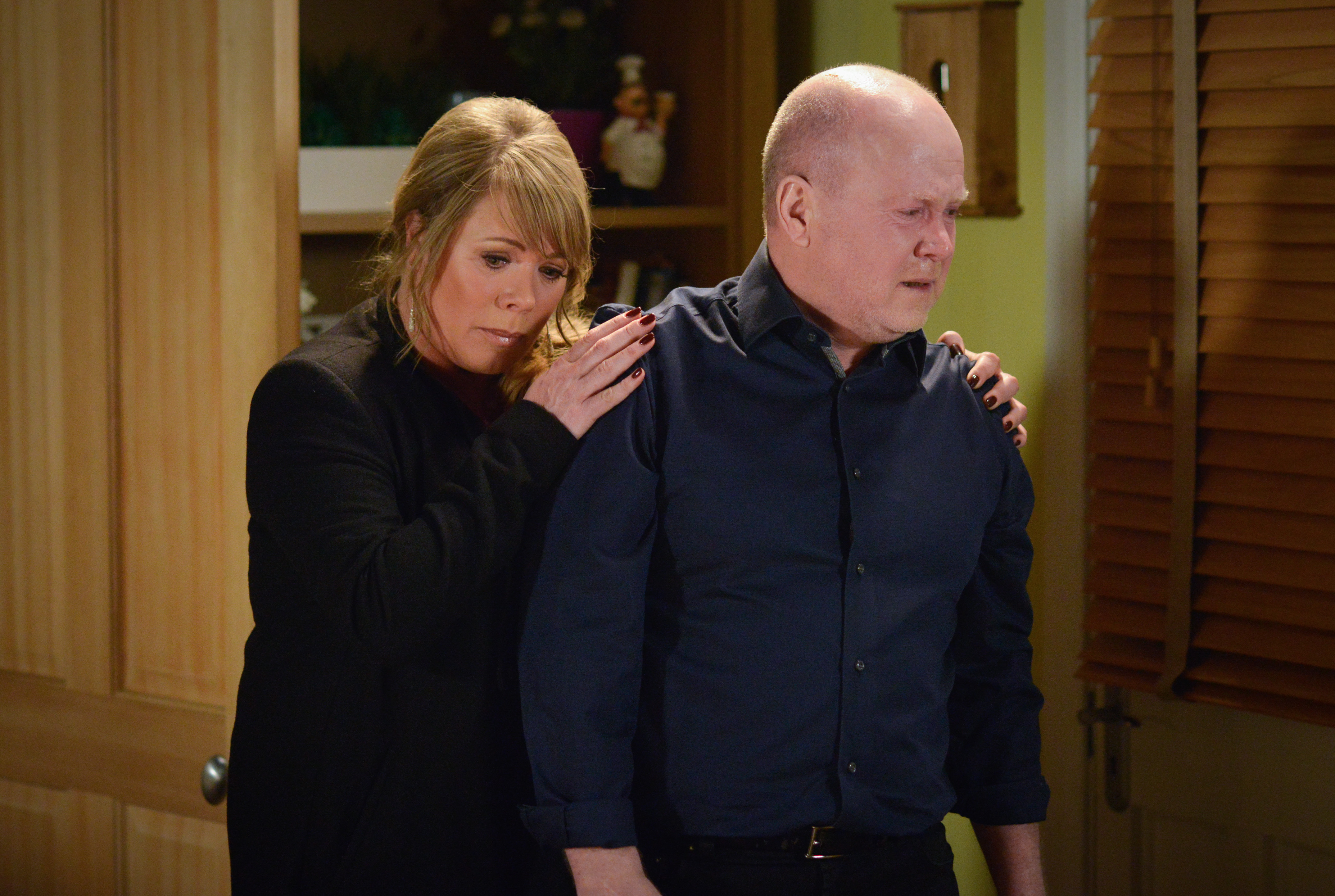 WARNING: Embargoed for publication until 00:00:01 on 10/05/2016 - Programme Name: EastEnders - TX: 19/05/2016 - Episode: EastEnders April - June 2016 - 5287 (No. n/a) - Picture Shows: +HOLD BACK FOR COMS+ Phil is devasted by Peggy's death as Sharon tries to comfort him. Sharon Mitchell (LETITIA DEAN), Phil Mitchell (STEVE MCFADDEN) - (C) BBC - Photographer: Kieron McCarron