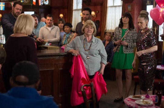 WARNING: Embargoed for publication until 00:00:01 on 21/06/2016 - Programme Name: EastEnders - TX: 28/06/2016 - Episode: EastEnders April - June 2016 - 5308 (No. n/a) - Picture Shows: *STRICTLY NOT FOR PUBLICATION UNTIL 00:01HRS, TUESDAY 21st JUNE, 2016* ***FORTNIGHTLIES PLEASE DO NOT USE (SOAP LIFE AND ALL ABOUT SOAP) Pam tries to stop Babe. Mick Carter (DANNY DYER), Pam Coker (LIN BLAKLEY), Aunt Babe (ANNETTE BADLAND), Honey Mitchell (EMMA BARTON), Linda Carter (KELLIE BRIGHT) - (C) BBC - Photographer: Jack Barnes