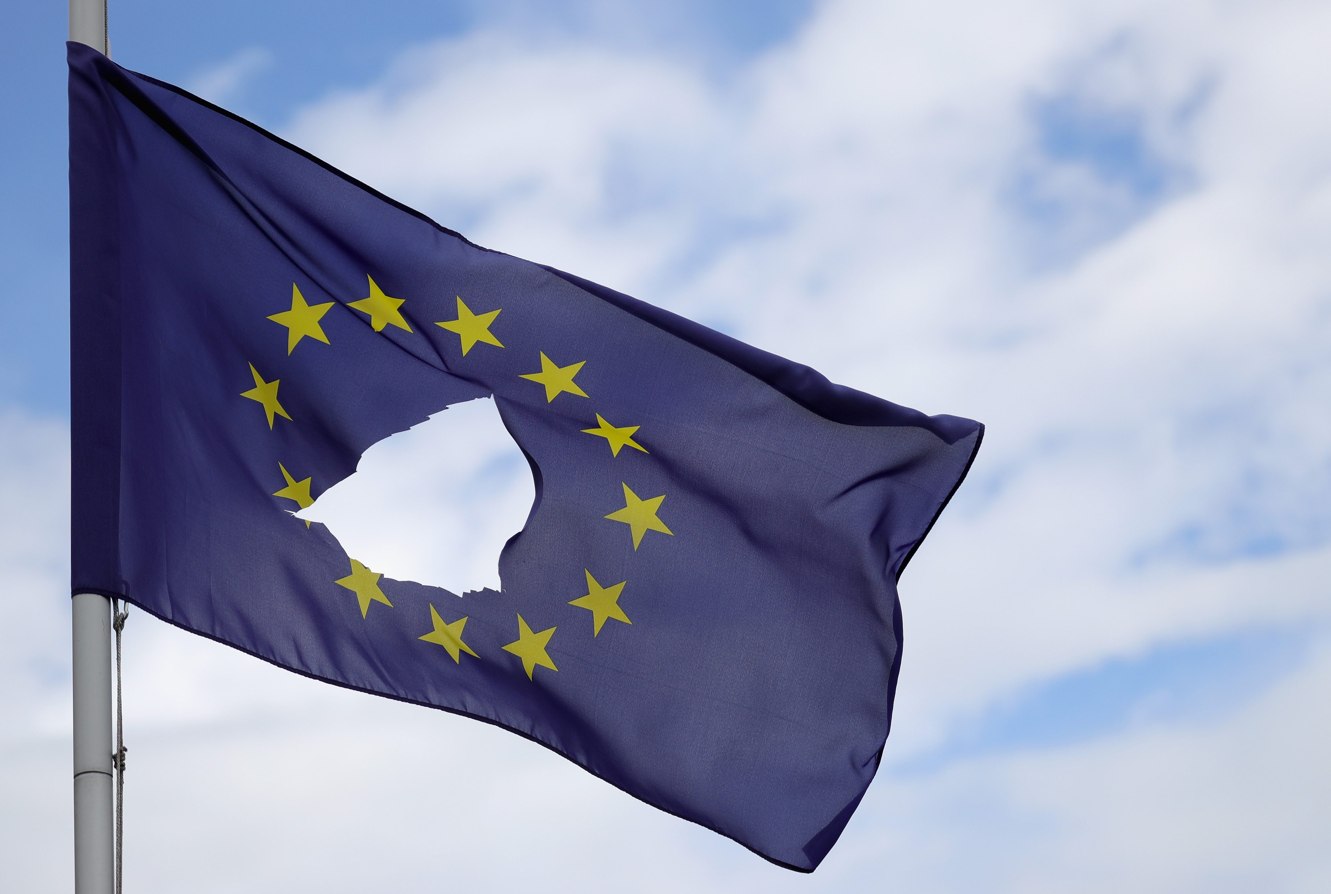 KNUTSFORD, UNITED KINGDOM - JUNE 24: A European Union flag, with a hole cut in the middle, flies at half-mast outside a home in Knutsford Cheshire after today's historic referendum on June 24, 2016 in Knutsford, United Kingdom. The results from the historic EU referendum has now been declared and the United Kingdom has voted to LEAVE the European Union. (Photo by Christopher Furlong/Getty Images)