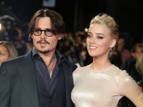 Amber Heard claims estranged husband Johnny Depp is holding up their divorce
