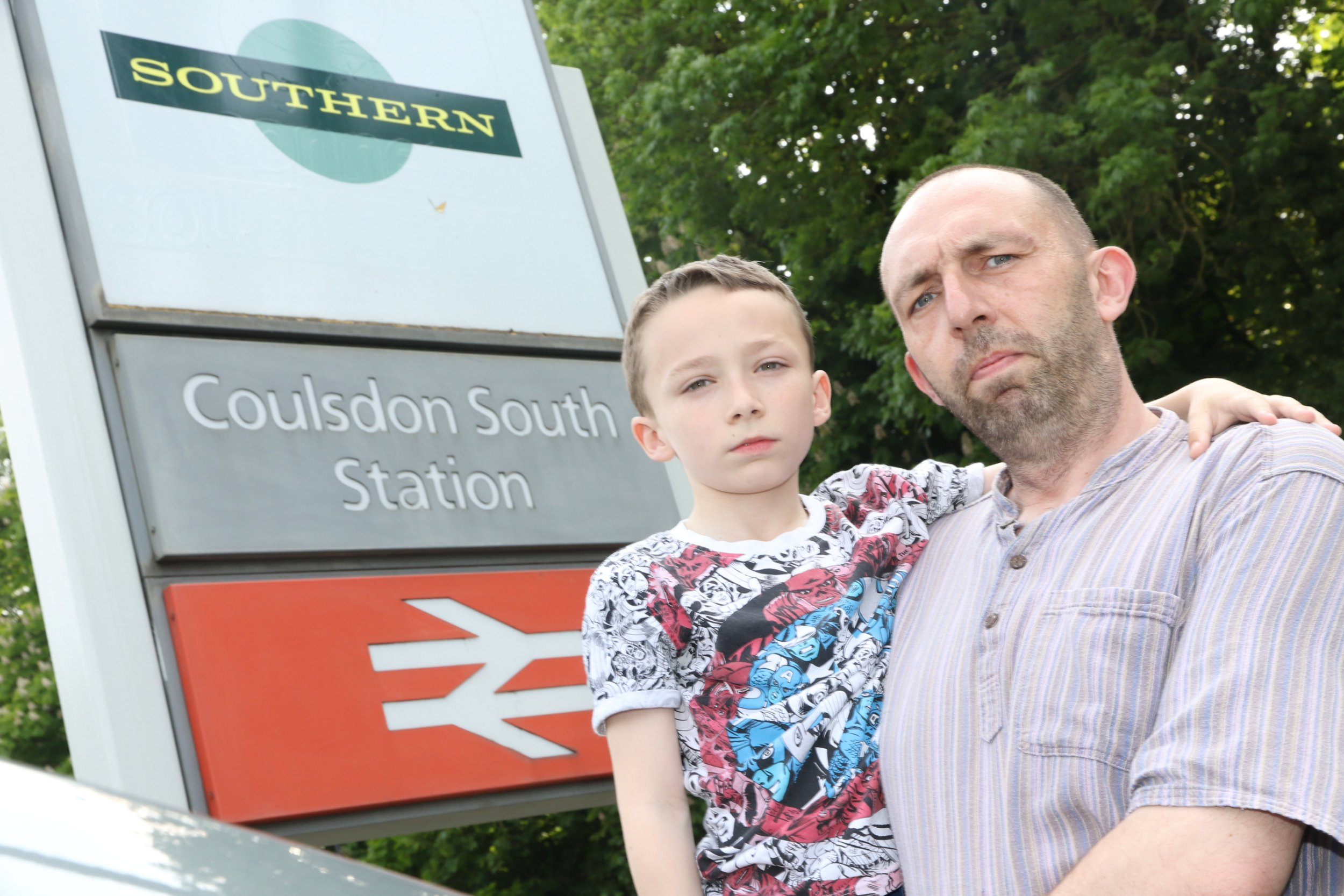 "Lee Fenton who lost his job after train company Southern Rail cancelled his train three days in a row. He is pictured here with his son Alex. See National News story NNRAIL; A Coulsdon man claims Southern has cost him his job after he was dismissed for being late three days in a row. Lee Fenton was 30 minutes late on the first three days of a temporary placement with Merton Council after the 7.33am service from Coulsdon South was cancelled on Monday, Tuesday and Wednesday of last week (May 23, 24, and 25). The dismissal has left Mr Fenton with no income to support wife Charlotte and eight-year-old son Alex, or pay the mortgage of their Southlands Close home, he said. ""I lost my job because I was relying on the trains to get me to work and because they are continually cancelled or late I was late to work and they dismissed me,"" Mr Fenton said."