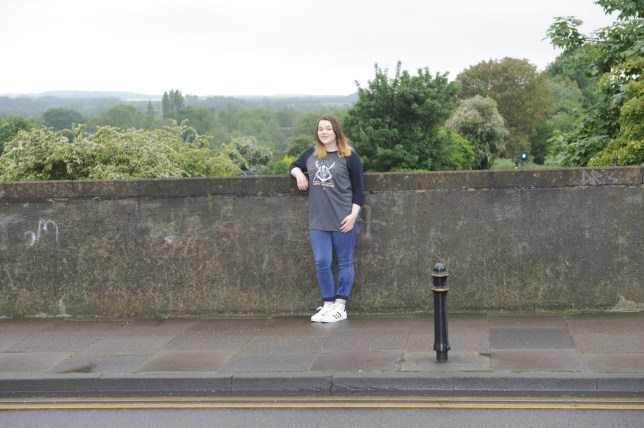Hannah Simmons on the railway bridge in Canterbury where she stopped a suicidal man from throwing himself off a bridge onto a railway - just 18 months after saving someone else's life when they collapsed on a train. See National copy NNLIFE; Hannah Simmons, 15, bravely stepped in to help when she spotted someone perched on a ledge over the train tracks. The courageous youngster managed to talk him down from the ledge in Canterbury, Kent, but was faced with another challenge when he then tried to walk into fast-moving traffic. Hannah, from Faversham, Kent, said: ìI was walking towards the station and I saw this man sitting on the bridge and I could tell straight away something was up.