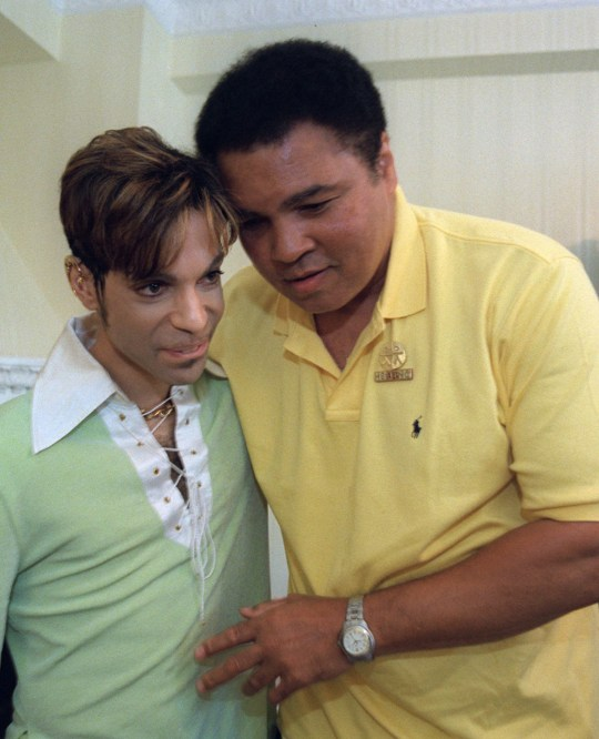 Boxing great Muhammad Ali, right, embraces the Artist Formerly Known as Prince, during a meeting in Washington Tuesday, June 24, 1997 prior to a news conference where they were to announce plans for a benefit concert in October. The World Healing Honors will be a grand benefit concert to promote international harmony and tolerance. (AP Photo/Karin Cooper/Rogers & Cowan)