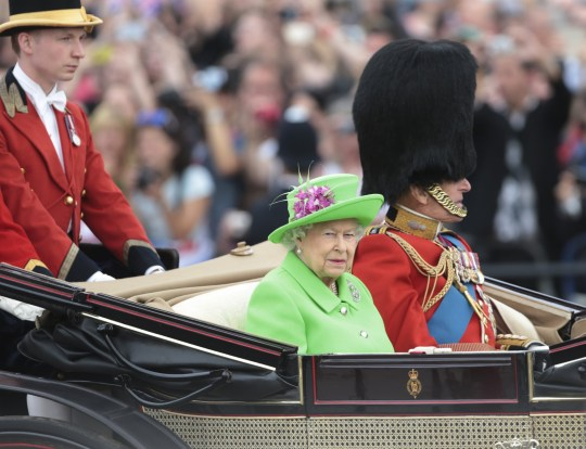 """Her Majesty Queen Elizabeth 11 (L) and the Duke of Edinburgh (R) travel in an open state carriage during the annual """"Trooping the Colour"""" this year to celebrate the Queen's 90th birthday celebrations at The Mall in London June 11, 2016. The ceremony is Queen Elizabeth 11 annual birthday parade and dates back to the era of King Charles 11. PHOTOGRAPH BY UPI / Barcroft Images London-T:+44 207 033 1031 E:hello@barcroftmedia.com - New York-T:+1 212 796 2458 E:hello@barcroftusa.com - New Delhi-T:+91 11 4053 2429 E:hello@barcroftindia.com www.barcroftimages.com"""
