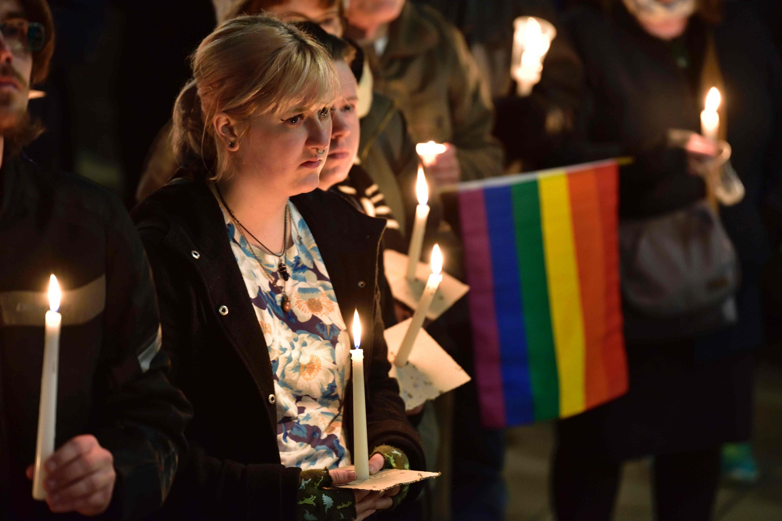 Participants hold candles during a vigil at Frank Kits Park in Wellington on June 13, 2016, in remembrance of victims after a gunman opened fire in a gay nightclub in Orlando, Florida in the worst mass shooting in US history...US anti-terror strategy came under fresh scrutiny after a gunman previously cleared of jihadist ties launched a hate-fueled rampage in a Florida gay club that left 50 dead. / AFP PHOTO / Marty MelvilleMARTY MELVILLE/AFP/Getty Images