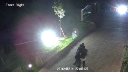 Video grab from CCTV which shows a woman being carried into her home by two robbers wearing balaclavas. See MASONS story MNROBBED; This is the shocking moment a woman was viciously dragged off the street and into her home by robbers who stole a safe and made off in her car. The woman in her 20s, who does not wish to be named, was outside smoking a cigarette when the she was grabbed by two men and bundled inside. A third man then joined them and helped to steal a heavy safe which was loaded into the victim's car, a brown Honda 4x4 with the registration number plate 8PXB. The offenders - described as white - were wearing balaclavas and gloves and were armed with a hockey stick. Police are now appealing for information and witnesses in connection with the robbery in Harpenden, Herts., on May 14, and the incident will be featured on BBC1's Crimewatch Roadshow next week. As a result of the attack, the victim says she is now afraid to be alone in her home.