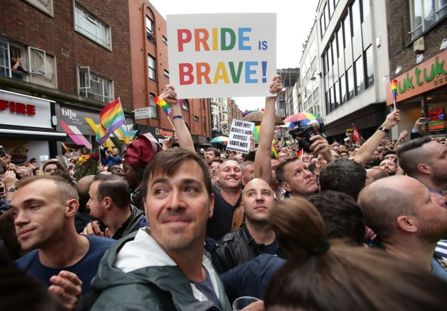 People gathered on Old Compton Street, London, during a vigil for the victims of the Orlando Shootings at a Gay nightclub in Florida. PRESS ASSOCIATION Photo. Issue date: Monday June 13, 2016. See PA story POLICE Pulse. Photo credit should read: Yui Mok/PA Wire