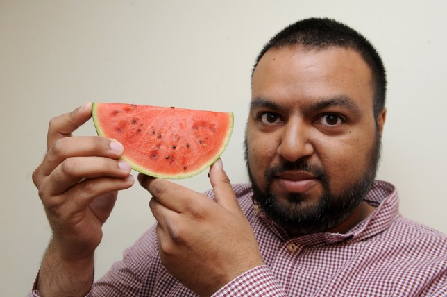 Asif Iqbal who has found the word Allah inside a water melon. A house in Hamilton, Leicester, has become a pilgrimage destination after a family discovered the name Allah written in Arabic inside a watermelon. See NTI story NTIMELON. Last Thursday, father-of-four Asif Iqbal, 31, cut open the gourd which he had bought from his local Tesco, and to his amazement found the holy name emblazoned in the fibres of the fruit. Word of the manifestation soon spread to friends and neighbours and before long a non-stop stream of visitors was going in and out of the family home, drawn by the divine discovery.