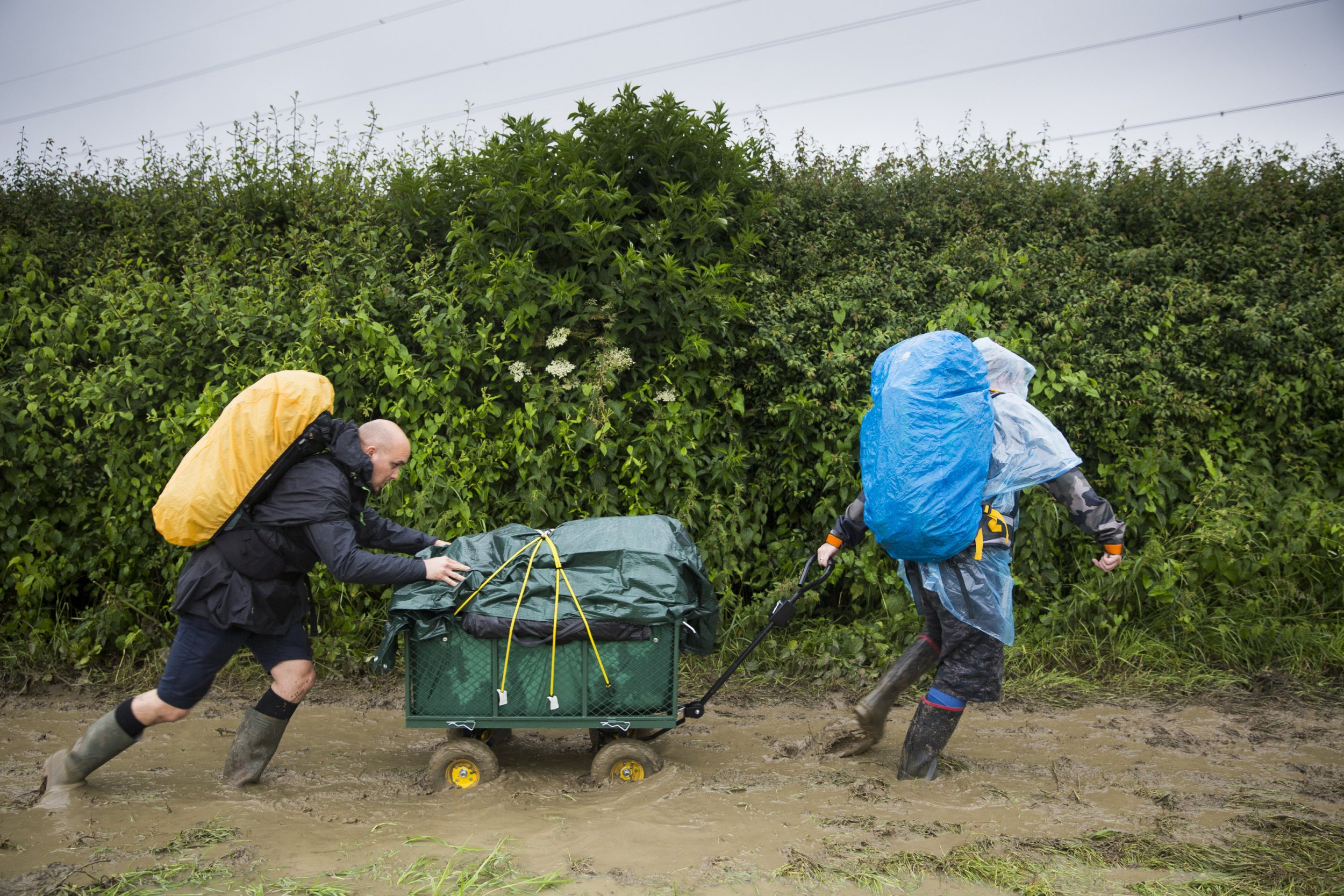 Revellers arrive at Glastonbury Festival this morning amid the heavy rain and muddy conditions . June 22 2016.
