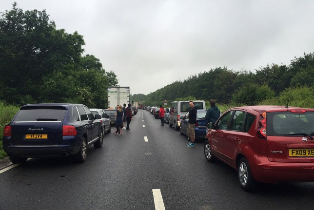 Traffic at a standstill on the A303 before Stonehenge near Amesbury, Wiltshire, as people head to Glastonbury Festival, with over 180,000 festival goers expected to pour in over the rest of the week to see hundreds of acts including headliners Muse, Adele and Coldplay on the famous Pyramid Stage. PRESS ASSOCIATION Photo. Picture date: Wednesday June 22, 2016. See PA story SHOWBIZ Glastonbury. Photo credit should read: Sally Wardle/PA Wire