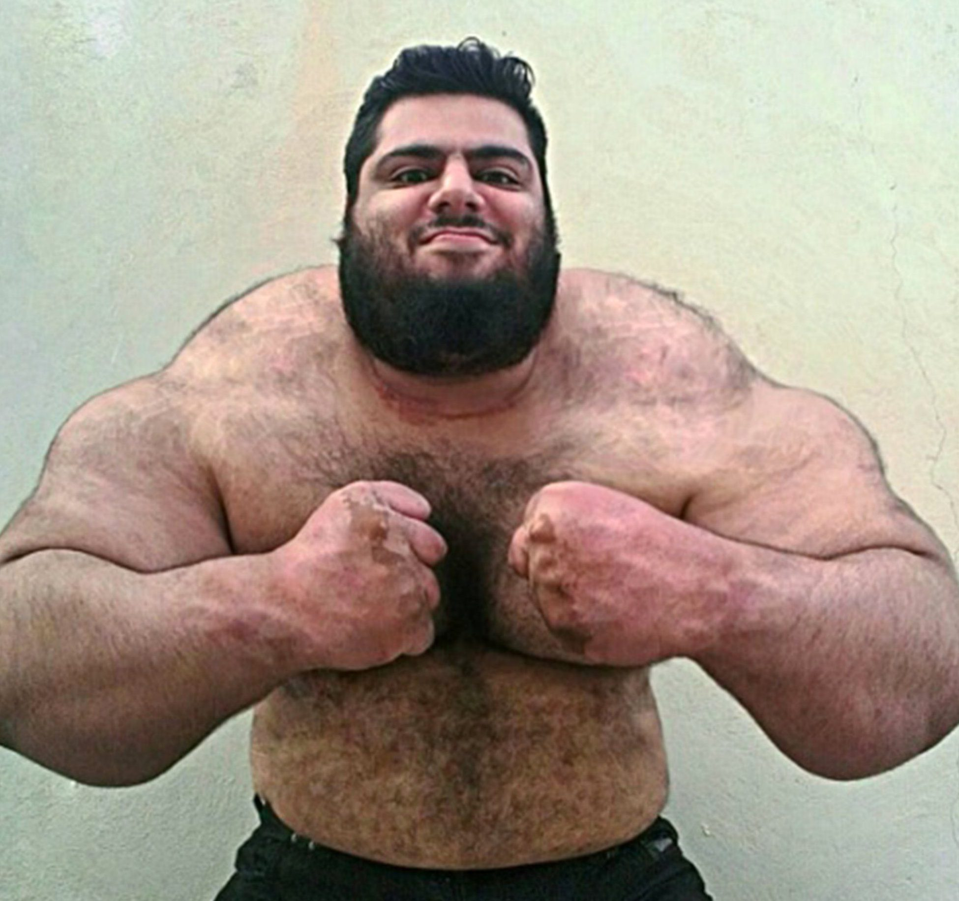 Pic shows: Saraj Gharibi. This is the Persian Hercules or Iranian Hulk, a huge weightlifter from Iran who is astounding social media with his sheer physical size. Sajad Gharibi, 24, is from Iran and is said to weigh almost 24 and a half stone, almost all of it muscle. Sajad has a following of over 59,000 followers of Instagram where he posts photos of his day to day life, as well as doing what he does best ñ weightlifting. The enormous man can lift up to 175 Kg (386 lbs), which is more than he weighs in the power lift category of competitions. He has also participated in bodybuilding competitions representing his country. The man is pictured in various images showing his huge frame and bulging muscles, which have earned himself the name of Hulk or Hercules. Since becoming noticed on his social media accounts, the Persian Hercules has become an internet sensation for his indomitable build. In his free time, he also likes to take pictures with objects that look smaller when held next to him. However those who know him assure that despite his grizzly appearance, Sajad has a big heart and is a gentle giant. (ends)