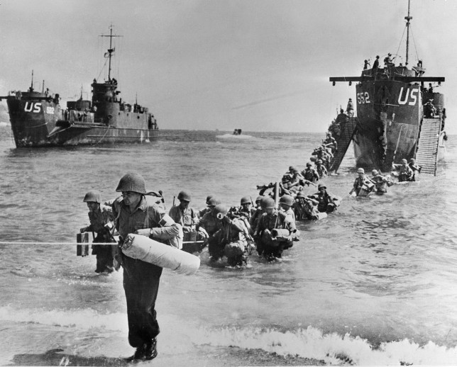 War & Conflict, World War Two, France, August 1944, American troops and their equipment disembark from US Navy landing craft onto a beach east of Toulon during the Allied invasion of southern France (Photo by Popperfoto/Getty Images)