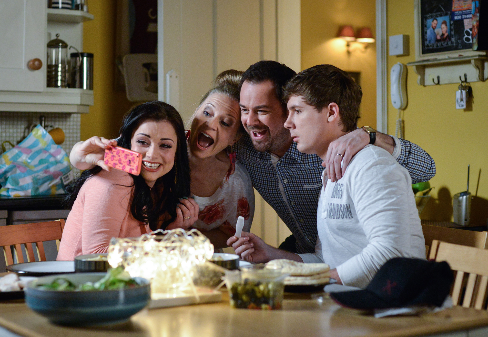WARNING: Embargoed for publication until 00:00:01 on 12/07/2016 - Programme Name: EastEnders - July - September 2016 - TX: 19/07/2016 - Episode: EastEnders July - September 2016 - 5318 (No. n/a) - Picture Shows: *STRICTLY NOT FOR PUBLICATION UNTIL 00:01HRS, TUESDAY 12th JULY, 2016* Mick & Linda celebrate with Whitney & Lee at the prospect of being grandparents. Whitney Dean (SHONA MCGARTY), Linda Carter (KELLIE BRIGHT), Mick Carter (DANNY DYER), Lee Carter (DANNY-BOY HATCHARD) - (C) BBC - Photographer: Kieron McCarron