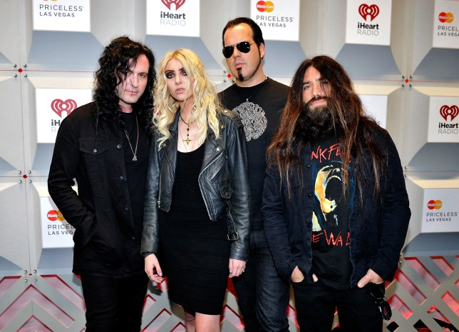 LAS VEGAS, NV - SEPTEMBER 19:  (L-R) Musician Ben Phillips, actress/singer Taylor Momsen, musicians Mark Damon and Jamie Perkins of the band The Pretty Reckless attend the 2014 iHeartRadio Music Festival at the MGM Grand Garden Arena on September 19, 2014 in Las Vegas, Nevada.  (Photo by David Becker/Getty Images for iHeartMedia)