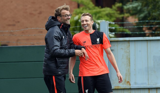 LIVERPOOL, UNITED KINGDOM - JULY 02: THE SUN OUT. THE SUN ON SUNDAY OUT. Jurgen Klopp manager of Liverpool with Lucas of Liverpool during the first day back at Training in Melwood Training Ground on July 2, 2016 in Liverpool, England. (Photo by John Powell/Liverpool FC via Getty Images)