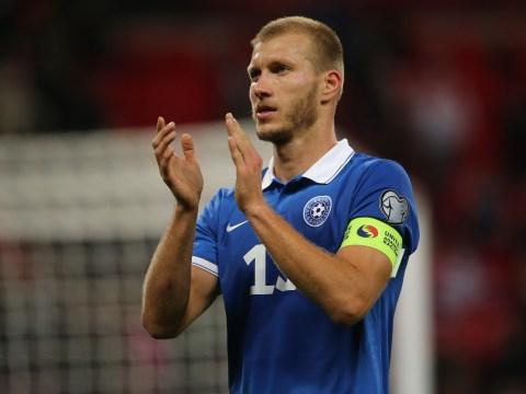 Augsburg defender Ragnar Klavan arrives in Liverpool to undergo medical