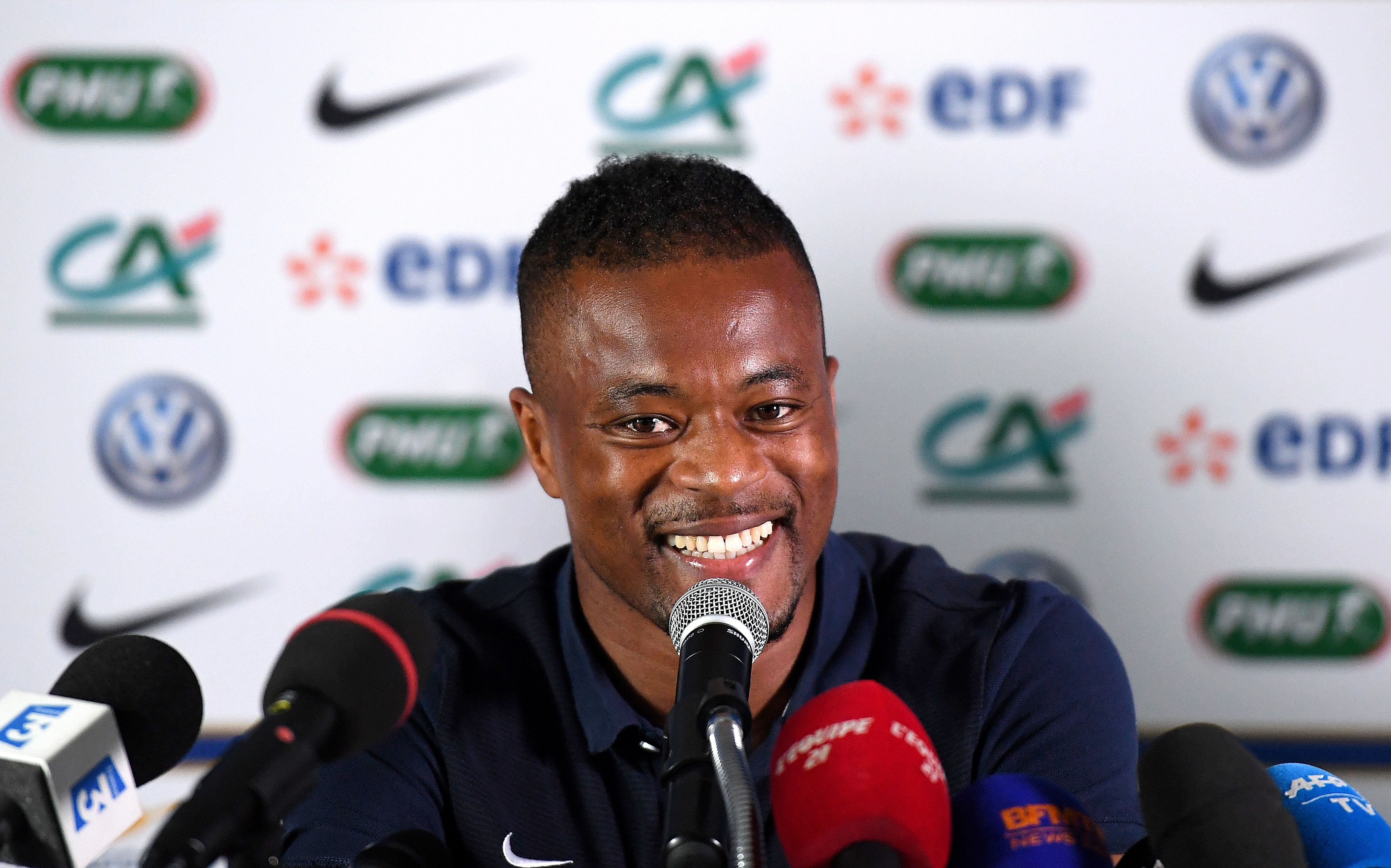 Manchester United legend Patrice Evra shows his colours after encounter with young France supporter