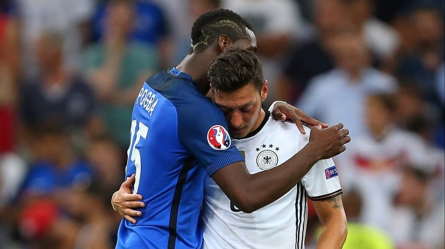 MARSEILLE, FRANCE - JULY 07: Paul Pogba of France consoles Mesut Ozil of Germany at the end of the UEFA Euro 2016 Semi Final match between Germany and France at Stade Velodrome on July 7, 2016 in Marseille, France. (Photo by Catherine Ivill - AMA/Getty Images)