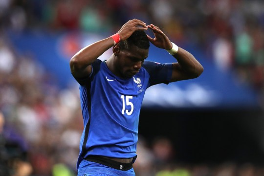 PARIS, FRANCE - JULY 10:  Paul Pogba of France looks dejected at the end of the UEFA Euro 2016 Final match between Portugal and France at Stade de France on July 10, 2016 in Paris, France.  (Photo by Matthew Ashton - AMA/Getty Images)