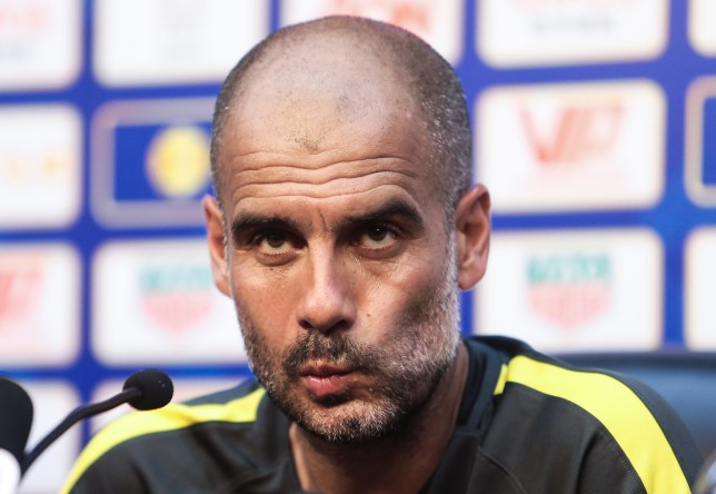 BEIJING, CHINA - JULY 24: Manchester City's manager Pep Guardiola attends a press conference for 2016 International Champions Cup match between Manchester City and Manchester United at Olympic Sports Centre Stadium on July 24, 2016 in Beijing, China.  (Photo by Stringer/Anadolu Agency/Getty Images)