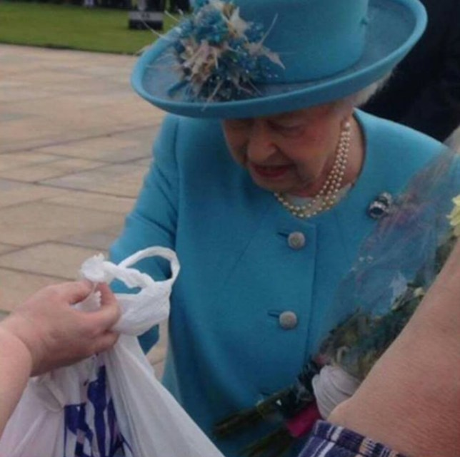 Woman gifts the Queen with white plastic bag with gifts for Charlotte and George